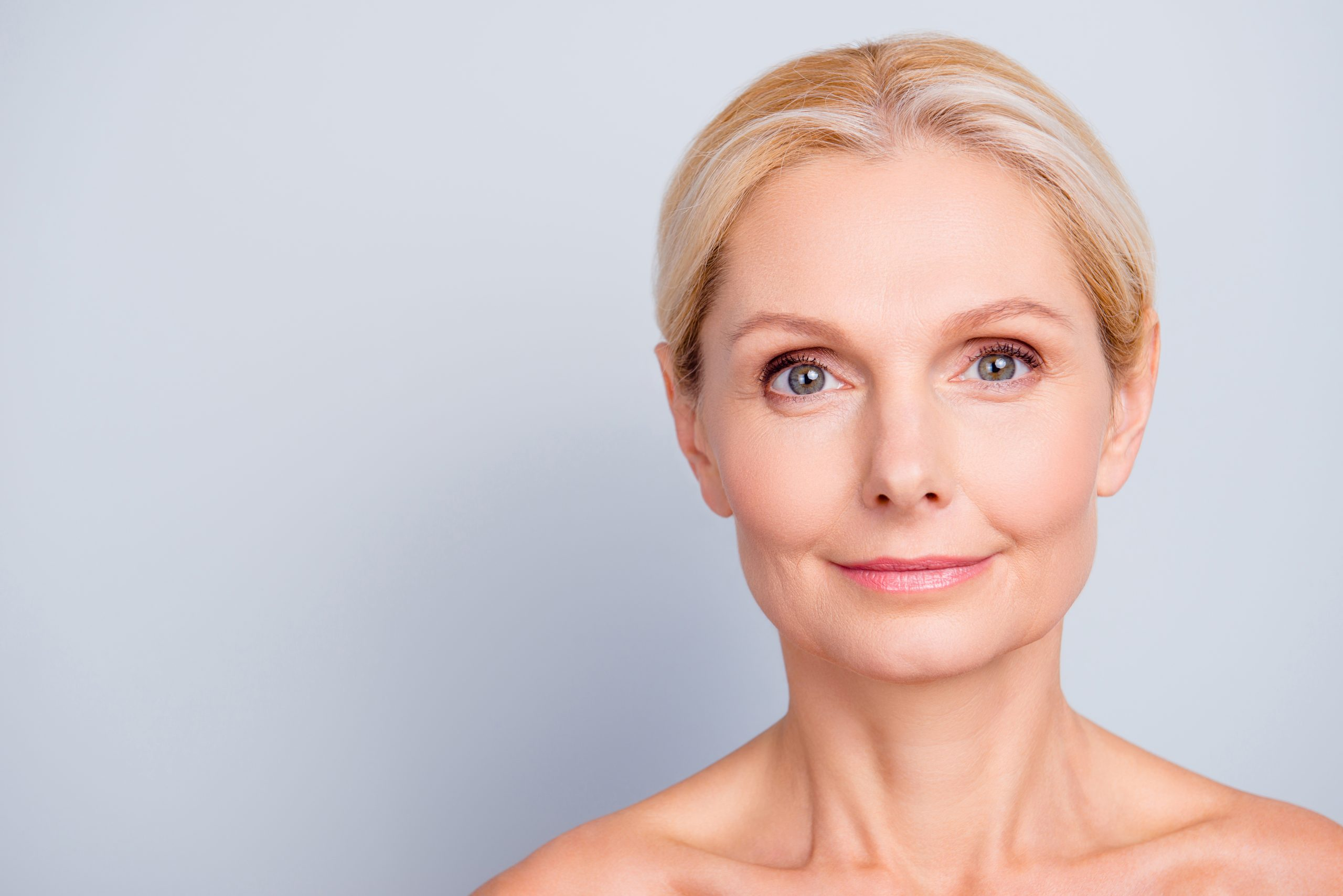 A middle aged woman with youthful skin free of wrinkles