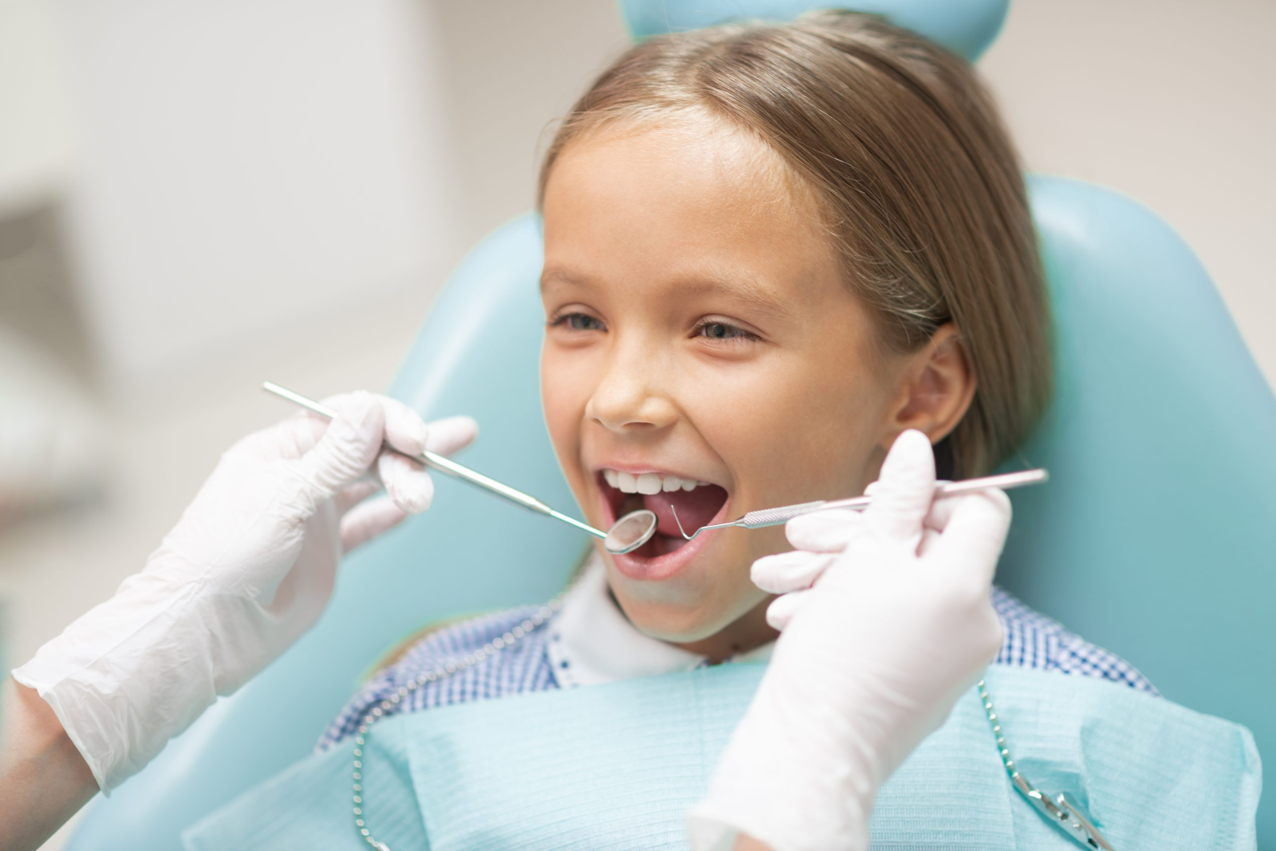 A little girl gets pre-orthodontic treatment